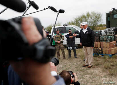 U.S. President Donald Trump talks to the media as he stands with U.S. Border Patrol agents on the banks of the Rio Grande River during his visit to the U.S.-Mexico border in Mission, Texas, Jan. 10, 2019.