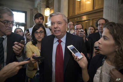 Sen. Lindsey Graham, R-S.C. is surrounded by reporters as he arrives at the Senate on Capitol Hill in Washington, July 27, 2017.