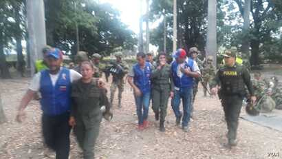 The Colombian migration authority provided photos Feb. 23, 2019, of some of the 23 Venezuelan uniformed personnel, including 20 soldiers, who crossed into Colombia and surrendered.
