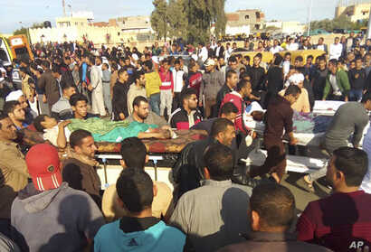 Injured people are evacuated from the scene of a militant attack on a mosque in Bir al-Abd in the northern Sinai Peninsula of Egypt, Nov. 24, 2017.