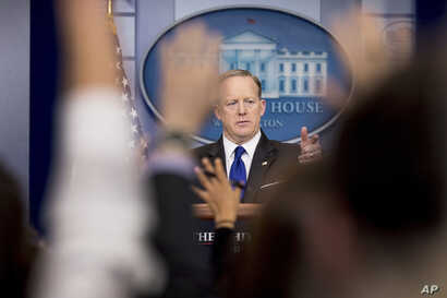 White House press secretary Sean Spicer takes a question from a member of the media during the daily press briefing at the White House in Washington, March 21, 2017.