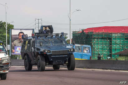 A police armored personnel carrier patrols in Kinshasa, DRC, Nov. 30, 2017, during a day of protest called for by the opposition parties to demand the departure of President Kabila.