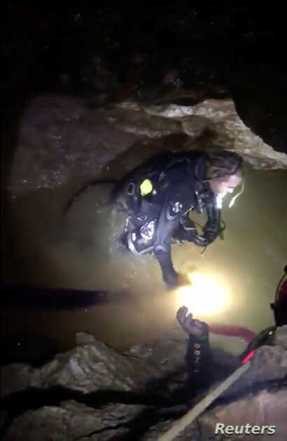 Ruamkatanyu Foundation rescuers are seen drillining ahead of the operation at the Tham Luang cave complex, where 12 boys and their soccer coach are trapped, in this screen grab of a video obtained on social media and taken July 7, 2018.