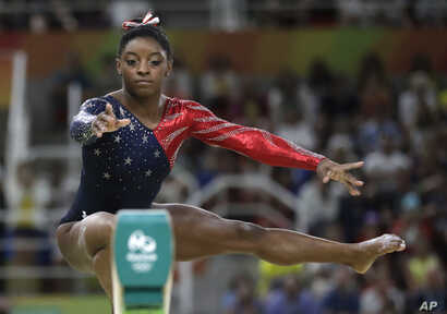 United States' Simone Biles performs on the balance beam during the artistic gymnastics women's qualification at the 2016 Summer Olympics in Rio de Janeiro, Brazil, Aug. 7, 2016.