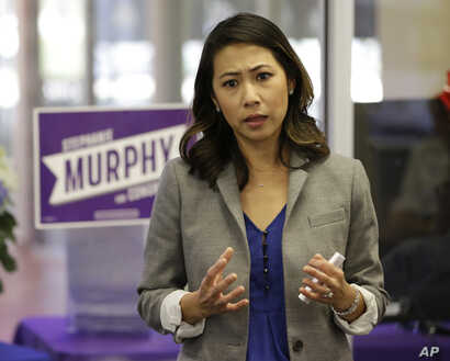 FILE - Florida Democratic Congressional candidate Stephanie Murphy meets with voters at a senior center in Altamonte Springs, Fla., Oct. 18, 2016.