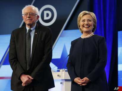 Democratic presidential candidates, Hillary Clinton and Sen. Bernie Sanders, I-Vt,  stand together before the start of the Univision, Washington Post Democratic presidential debate at Miami-Dade College,  March 9, 2016.