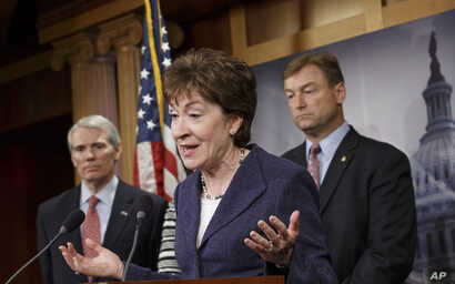 Sen. Susan Collins, R-Maine, center, flanked by Sen. Dean Heller, R-Nev., right, and Sen. Rob Portman, R-Ohio, left, discuss their concerns about the political fight over legislation to restore benefits to long-term jobless workers, Jan. 14, 2014, du...
