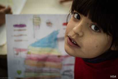 Children taking part in the Najda Now's drawing classes come live in Shatila, a Palestinian camp in the suburbs of Beirut, Dec. 4, 2015. (J. Owens/VOA)