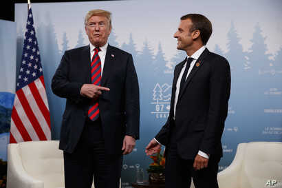 President Donald Trump meets with French President Emmanuel Macron during the G-7 summit, June 8, 2018, in Charlevoix, Canada.