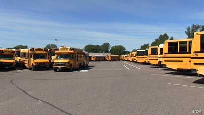 A fleet of Metropolitan Transportation Network buses in a parking lot at the company's headquarters in Fridley, Minnesota, Aug. 10, 2017.
