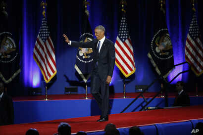 President Barack Obama waves as he arrives to speaks at McCormick Place in Chicago, giving his presidential farewell address, Jan. 10, 2017.