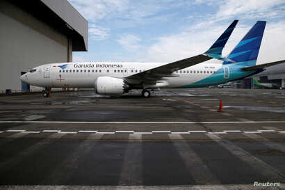FILE - A Garuda Boeing 737 Max 8 airplane is parked at the Garuda Maintenance Facility AeroAsia, at Soekarno-Hatta International airport near Jakarta, Indonesia, March 13, 2019.