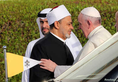 Pope Francis is welcomed by Grand Imam of al-Azhar Sheikh Ahmed al-Tayeb at the sheikh Zayed grand Mosque in Abu Dhabi, United Arab Emirates, Feb. 4, 2019.