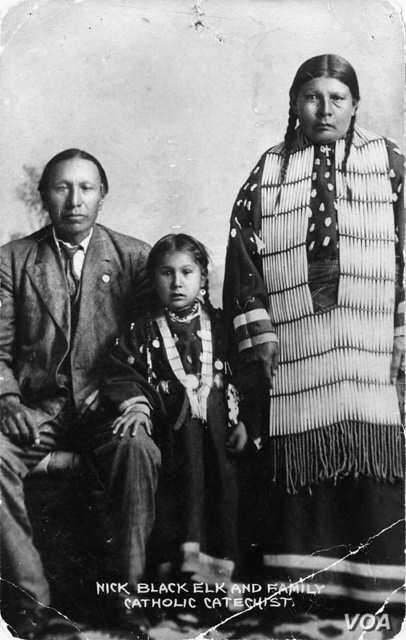 Black Elk, daughter Lucy Black Elk, and second wife Anna Brings White in their home in Manderson, South Dakota, about 1910