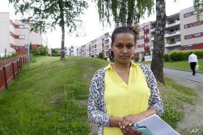 Hiweet Berhe Tesfamarian Kidane holds photocopies of documents she told the Associated Press belong to her brother Medhanie Tesfamariam Kidane in Oslo, June 9, 2016. Kidane said that her brother was misidentified for Medhane Yehdego Mered, an Erithre...