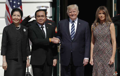 President Donald Trump and first lady Melania Trump greet Thailand's Prime Minister Prayuth Chan-ocha, and his wife Naraporn Chan-ocha at the White House in Washington, Oct. 2, 2017.