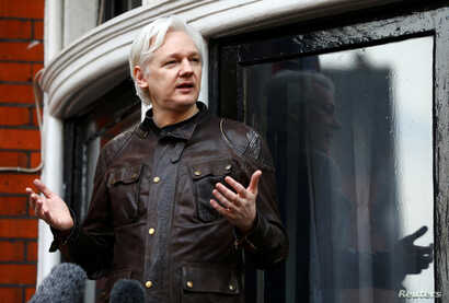 FILE - WikiLeaks founder Julian Assange is seen on the balcony of the Ecuadorian Embassy in London, Britain, May 19, 2017.