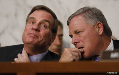 Committee Vice Chairman and ranking member Senator Mark Warner, left, and Chairman Richard Burr listen as U.S. Attorney General Jeff Sessions testifies before a Senate Intelligence Committee hearing on Capitol Hill in Washington, June 13, 2017.