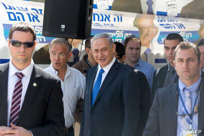 Israeli Prime Minister and Likud party's candidate running for general elections, Benjamin Netanyahu is surrounded by bodyguards during his visit in Har Homa, an Israeli settlement neighbourhood of annexed east Jerusalem, March 16, 2015