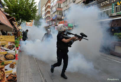 Riot police use tear gas to disperse demonstrators during a protest against the detention of two hunger-striking teachers in Ankara, Turkey, May 22, 2017.
