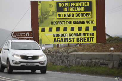 FILE - A motorist crosses over the border from the Irish Republic into Northern Ireland near the town of Jonesborough, Northern Ireland, Jan. 30, 2017.