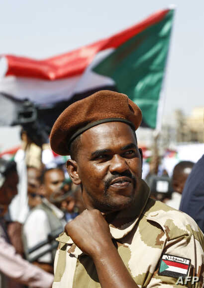 A member of the Sudanese security forces attends a rally for the supporters of President Omar al-Bashir in the Green Square in the capital Khartoum, Jan. 9, 2019.