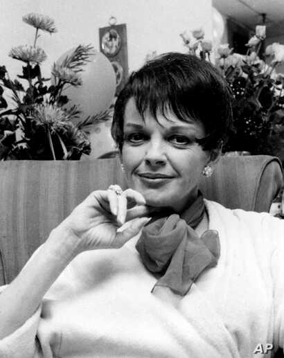 FILE - Judy Garland poses backstage at the Palace Theater in New York, July 31, 1967.