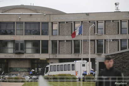 French gendarme and police stand at the entrance of the Fleury-Merogis prison near Paris after the arrival of a police convoy believed to be carrying Salah Abdeslam, believed to be the sole survivor among a group of Islamist militants who killed 130 ...