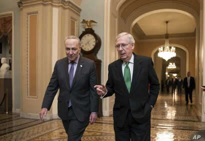 Senate Majority Leader Mitch McConnell, R-Ky., and Senate Minority Leader Chuck Schumer, D-N.Y., left, walk to the chamber after collaborating on an agreement on a two-year, nearly $400 billion budget deal that would provide Pentagon and domestic pro...