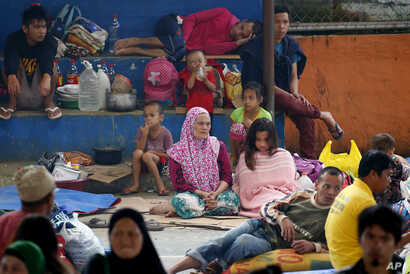 Displaced Marawi City residents rest at an evacuation center in Saguiaran township, Lanao del Sur province, May 28, 2017, in southern Philippines. Tens of thousands of residents are now housed in different evacuation centers as government troops figh...