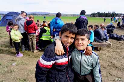 Children at Idomeni refugee camp on the Greece-Macedonia border, March 8, 2016. (Jamie Dettmer for VOA)