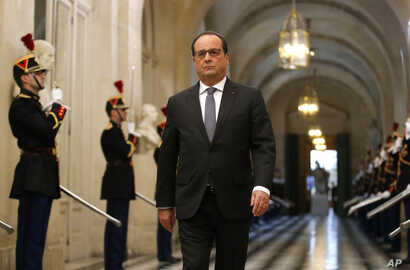 French President Francois Hollande arrives to deliver a speech at the Versailles castle, west of Paris, Monday, Nov.16, 2015.