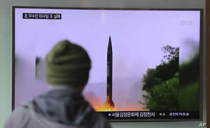"""A man in South Korea watches a TV news program showing a missile launch conducted by North Korea, Oct. 20, 2016. The U.S. military says called the event a """"failed"""" North Korean missile launch."""