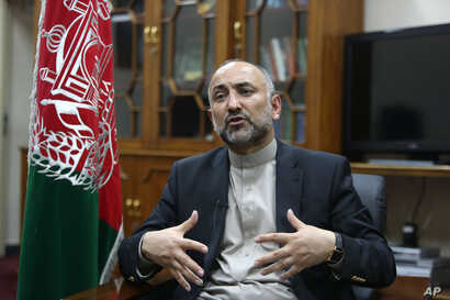 FILE - Afghan National Security Adviser Mohammad Hanif Atmar speaks during an interview with The Associated Press, in Kabul, Afghanistan.