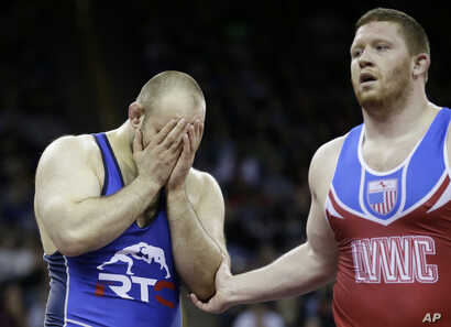 Tervel Dlagnev, left, reacts after beating Zach Rey in their 125-kilogram freestyle finals match at the U.S. Olympic Wrestling Team Trials, April 9, 2016, in Iowa City, Iowa.