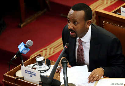 FILE - Ethiopia's Prime Minister Abiy Ahmed addresses the members of parliament inside the House of Peoples' Representatives in Addis Ababa, Ethiopia, April 19, 2018.