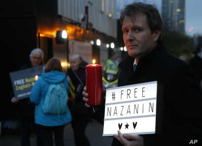 FILE -- Richard Ratcliffe husband of imprisoned charity worker Nazanin Zaghari-Ratcliffe, poses for the media during an Amnesty International led vigil outside the Iranian Embassy in London, Jan. 16, 2017.