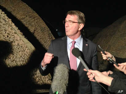 """U.S. Defense Secretary Ash Carter told his Afghan counterpart Friday in Jalalabad, Afghanistan, that the U.S. is """"with you,"""" committed to supporting Afghan security forces and building their capabilities for years to come. Carter is shown in Irbi..."""