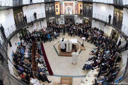 Pope Francis leads a Mass during his visit to the Regina Coeli detention center in Rome, March 29, 2018.