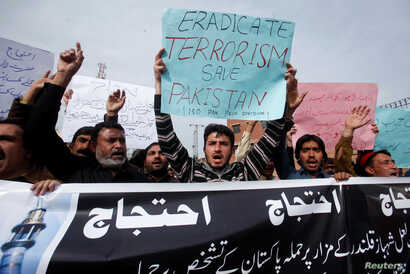 Protesters hold placards and chant slogans against the recent bomb blasts in various parts of Pakistan during a protest in Peshawar, Pakistan February 17, 2017.