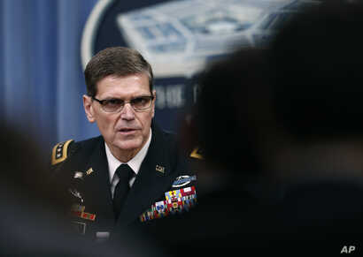 Gen. Joseph Votel speaks during a news conference with Defense Secretary Jim Mattis at the Pentagon, April 11, 2017. The commander of U.S. Central Command said it is looking to counter Iranian influence in the Middle East via cyberspace.