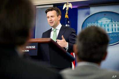 "FILE - White House press secretary Josh Earnest at a White House press briefing in Washington, Sept. 18, 2015. Earnest called Trump's calls for a ban on Muslims entering the country ""offensive and toxic."""
