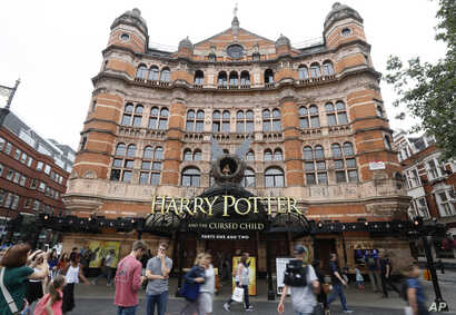 """FILE - The Palace Theatre in London advertises, July 28, 2016, the new Harry Potter play: """"Harry Potter and the Cursed Child,"""" a two-part stage drama that picks up 19 years after the novels ended."""
