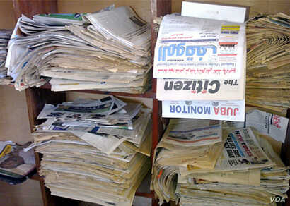 Stacks of South Sudanese newspapers sit on shelves in the office of the Association for Media Development in South Sudan (AMDISS) in Juba, a day after The Citizen media group was ordered by government officials to shut down.
