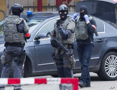 Special operations police secure an area during a police raid in the Molenbeek neighbourhood of Brussels, Belgium on March 18, 2016.