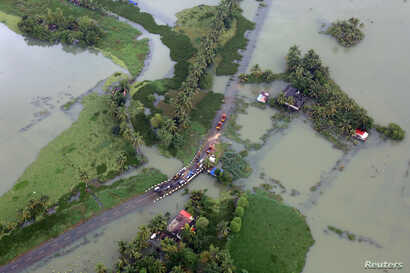 An aerial view shows partially submerged road at a flooded area in the southern state of Kerala, India, Aug. 19, 2018.