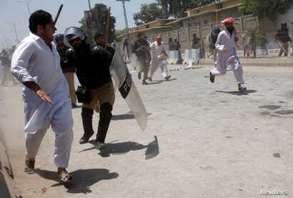 Police officers use batons to disperse protesters during a demonstration against the constitutional amendment bill for the merger of Federally Administered Tribal Areas (FATA) with Khyber Pakhtunkhwa (KPK) province, outside the assembly building in P...