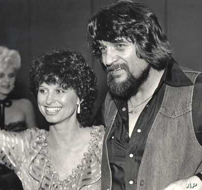 FILE - Country music legend Waylon Jennings, right, and his wife, country singer Jessi Colter, attend a party in Nashville, Tennessee, in July 1982.