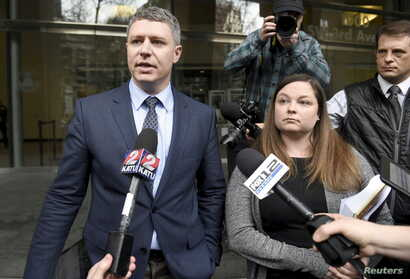 Michael Arnold, left, and Lissa Casey, attorneys representing Ammon Bundy, address the media covering the hearing of militia members outside United States District Court in Portland, Oregon, Jan. 27, 2016.