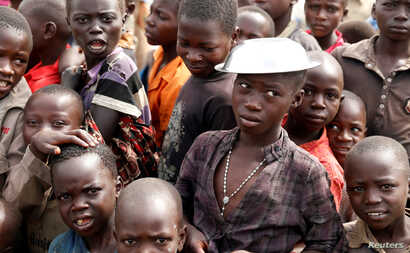Children wait for food distribution at an internally displaced persons camp in Bunia, Ituri province, eastern Democratic Republic of Congo, April 12, 2018.